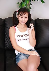 Chinese teen fingering her crotch