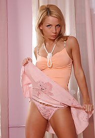 Blond dancing in the erotic manner