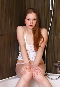 Curve redhead in the shower